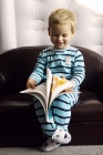 Reading by himself...