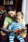 ...or with Mom. Kenyon just simply loves to read and be read to.