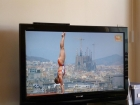 First of all...who\'s crazy enough to do a handstand on the platform anyway...but aside from this athlete\'s stunning abilities, check out the Sagrada Familia in the background!