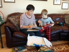 Opening the gift from the heart with Kenyon. I recorded myself reading some stories for him to listen to as he reads the books. Not sure he thought it was as fun as I did. :)