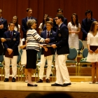 Head of School, Nancy Heuston awarding Clark his diploma. After 34 years, she is retiring with this Senior Class.