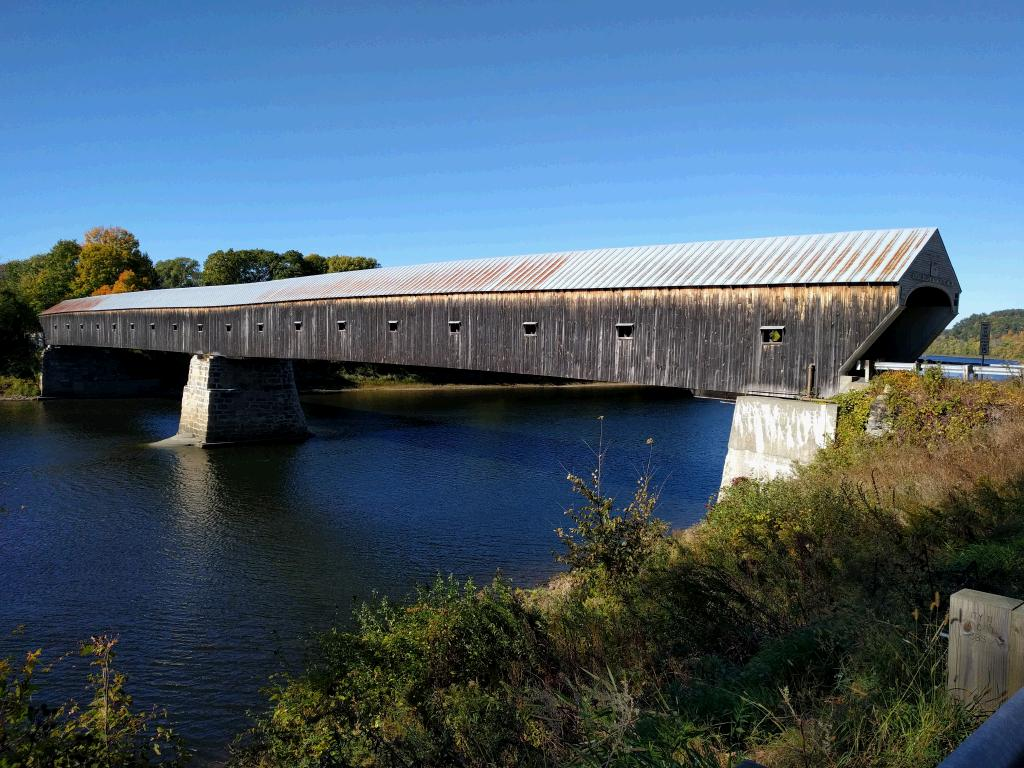 "Cornish Windsor Bridge at 460 feet is the largest two-span covered bridge in the world. It was built in 1866 at the cost of 9,000. On the front it says, ""Walk your horses, or pay 2.00 fine."""