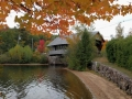 Three great elements - a covered bridge, fall foliage, and a rock wall. Super pretty.
