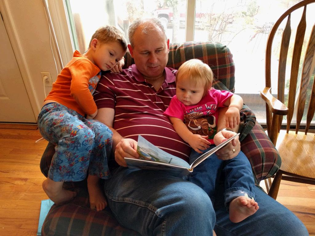 The kidlets love to be read to. Good thing everyone can fit on the chair together!