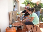 Pere, his daughter Sara and his friend Guillermo making paella for our families.